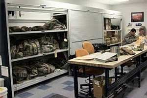 Shelving for storage of weapons, tactical gear